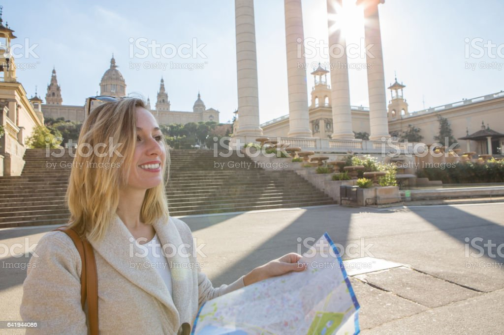 Tourist woman in Barcelona looking at map stock photo