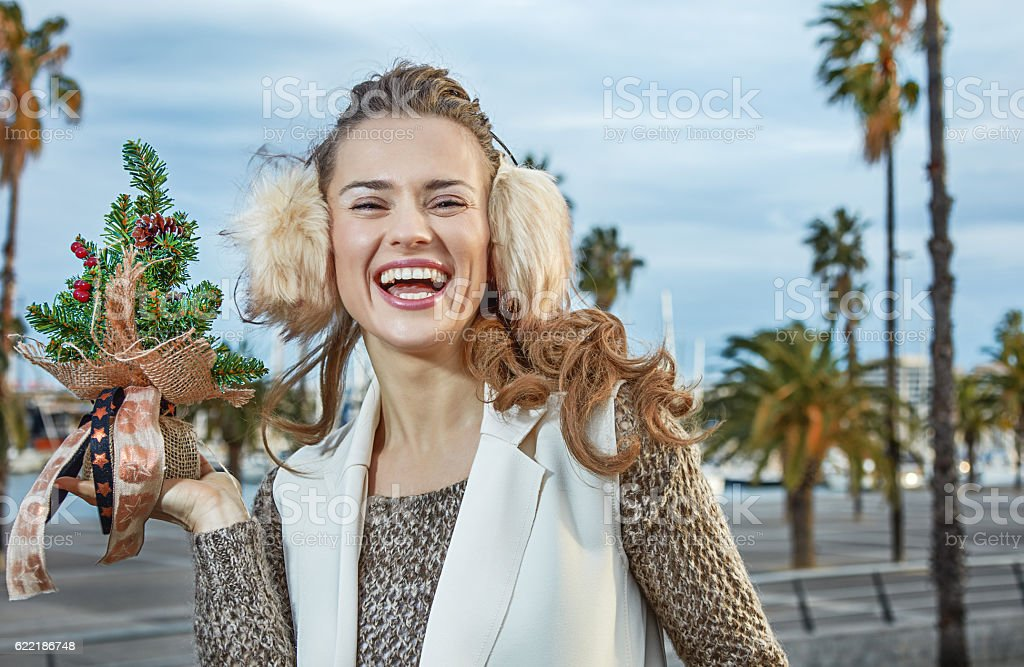 tourist woman in Barcelona showing a little Christmas tree stock photo