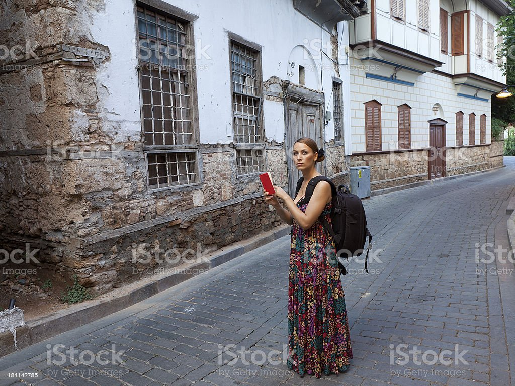Tourist woman lost in Kaleici, old town of Antalya royalty-free stock photo