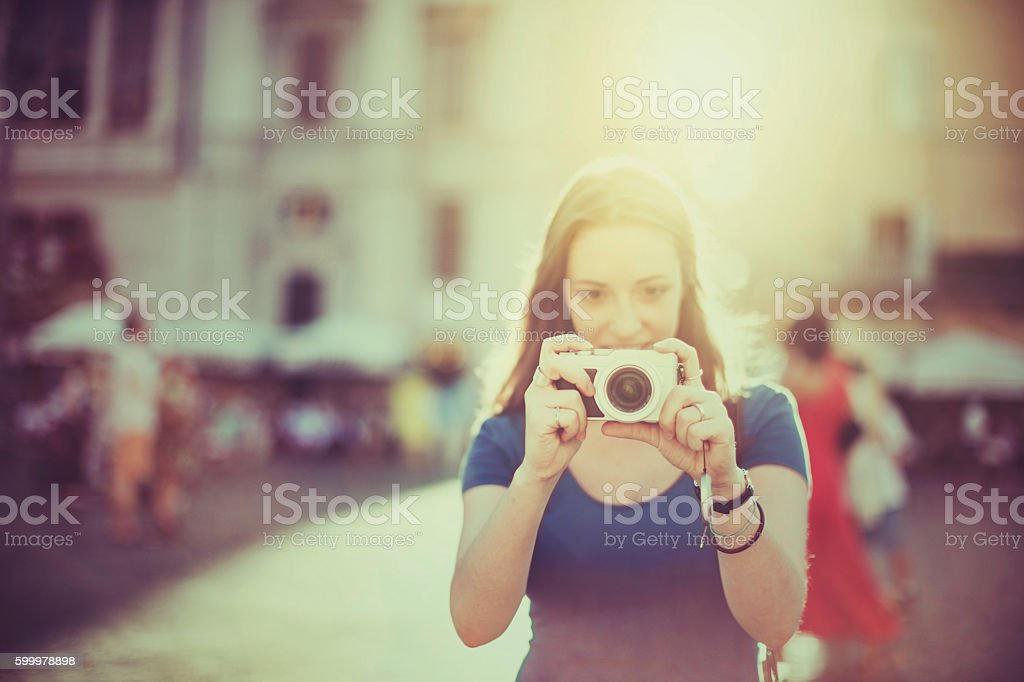 Tourist woman photographing with digital camera  in Rome stock photo