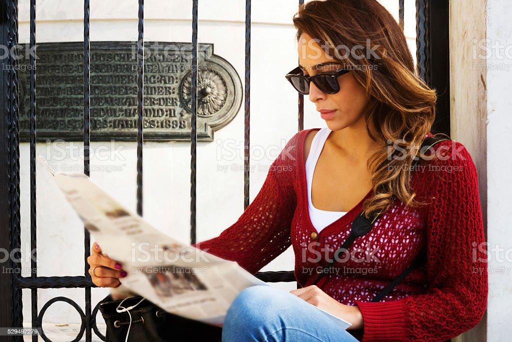 Tourist Woman Reading Newspaper stock photo
