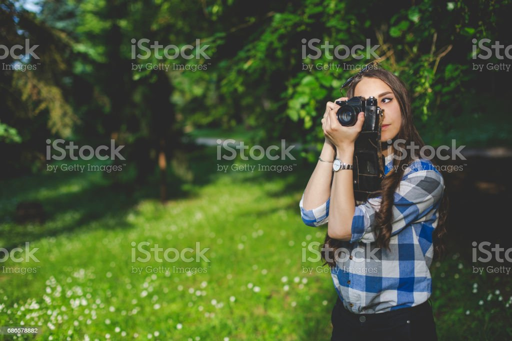 Tourist woman relaxing in the park stock photo