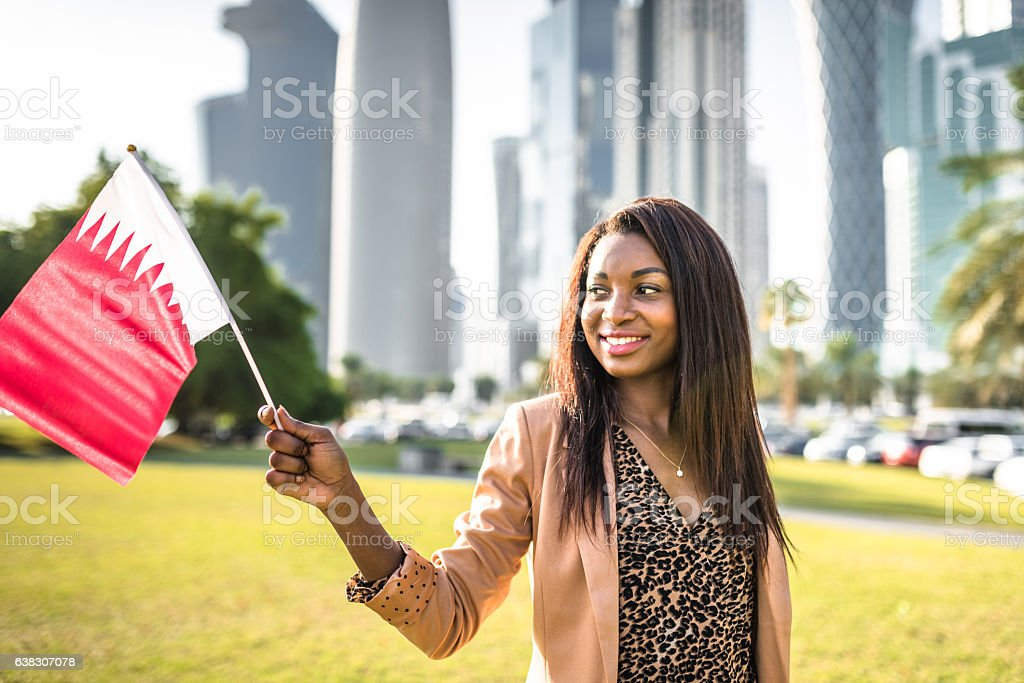 tourist woman relaxing on the park in doha stock photo