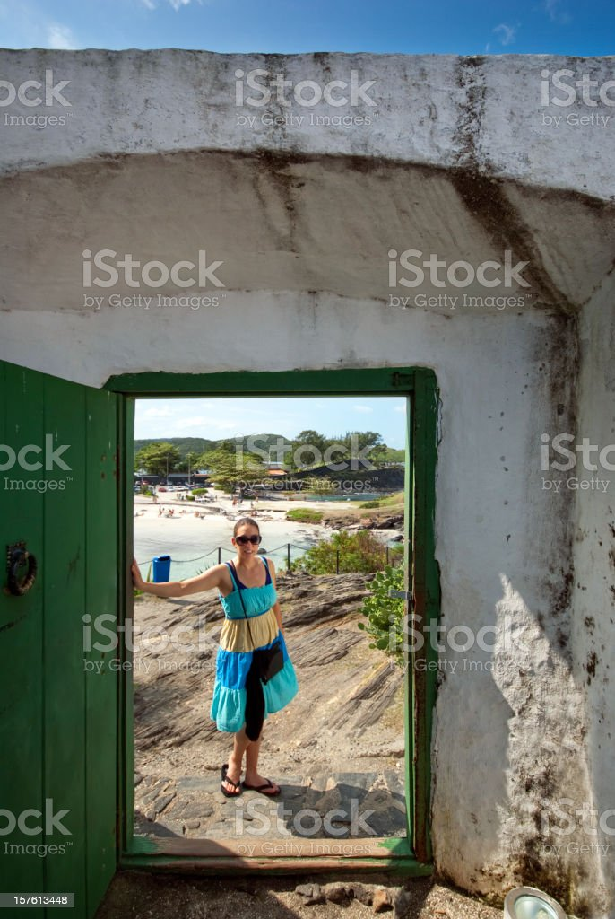 tourist woman standing in doorway stock photo