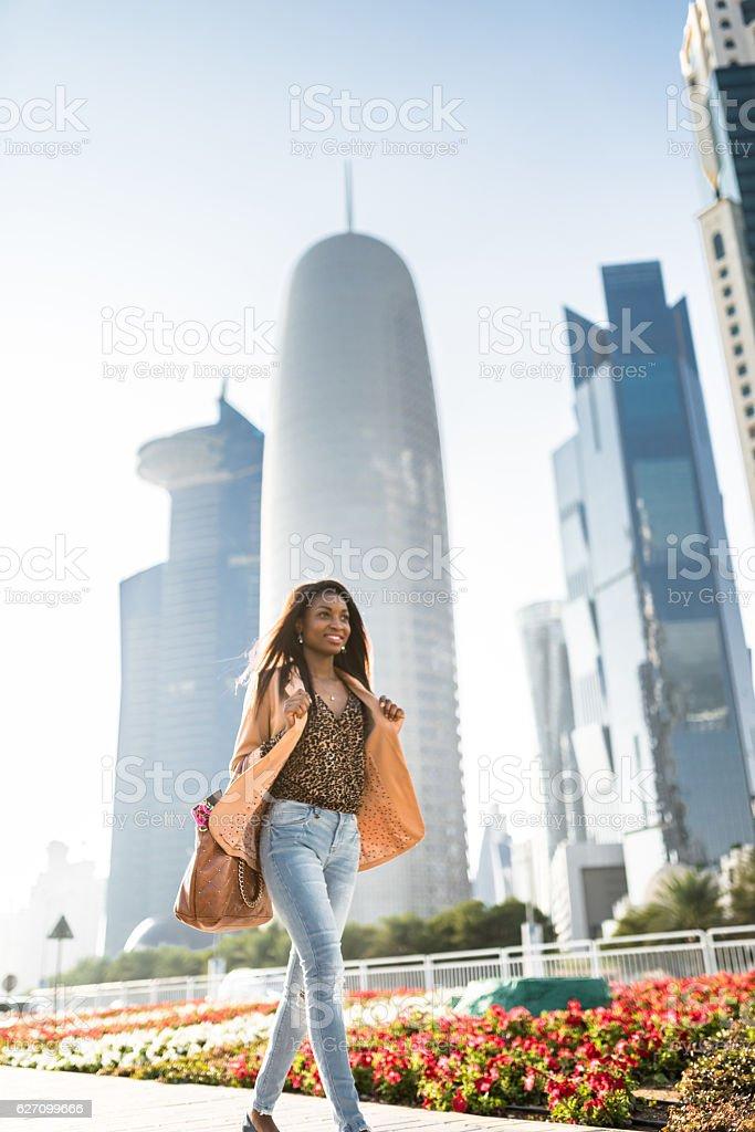 tourist woman walking in doha - qatar stock photo