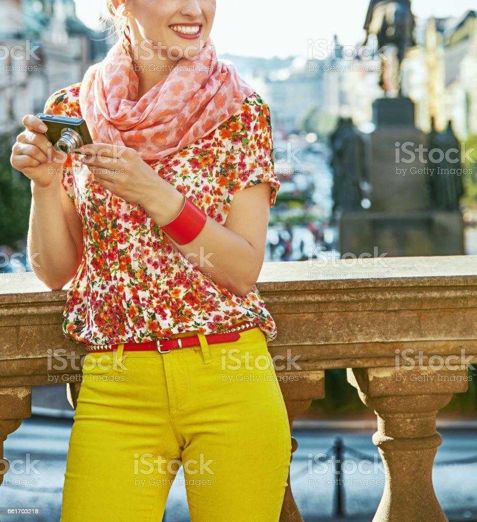 tourist woman with digital camera on Vaclavske namesti in Prague stock photo