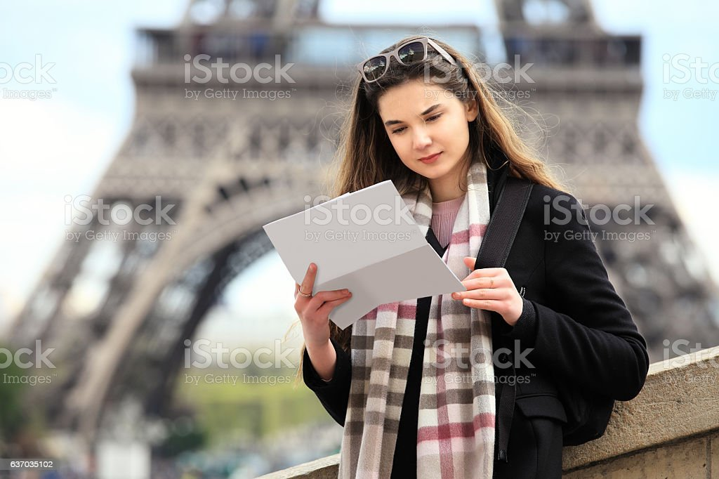 Tourist women in Paris holding a map stock photo
