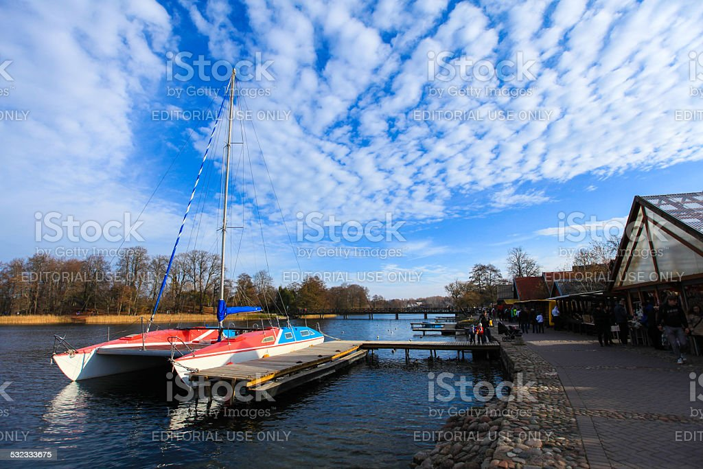 Tourist yacht in the docks near Trakai castle stock photo