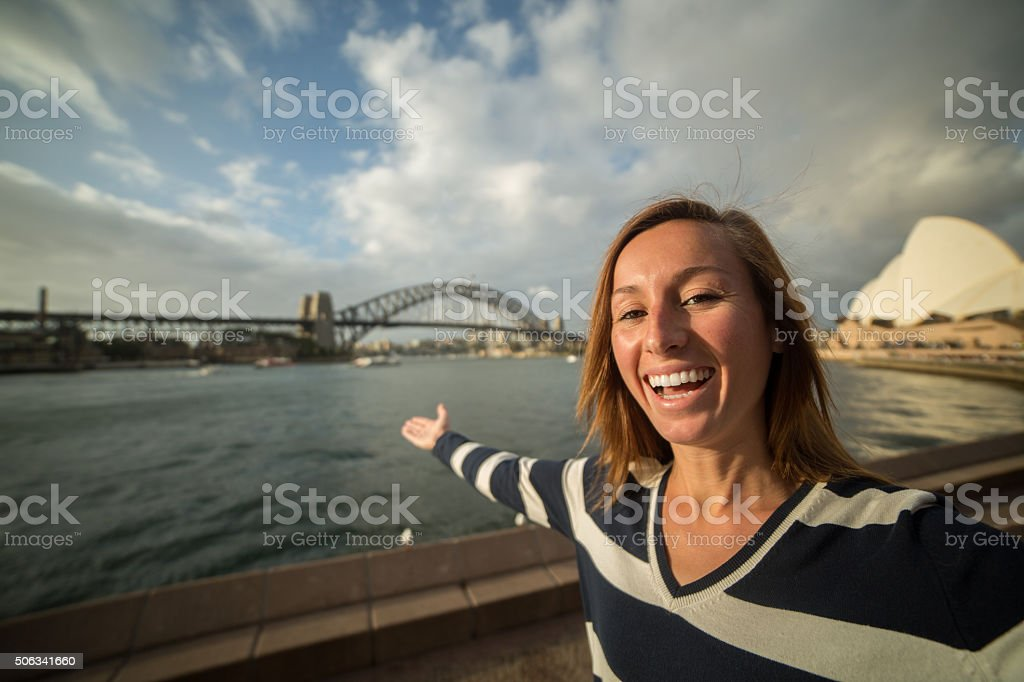Tourist young woman in Sydney takes a selfie portrait stock photo
