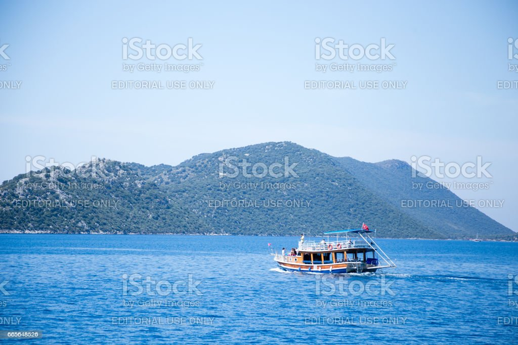 Touristic boat with Turkish flag in Mediterranean seascape stock photo