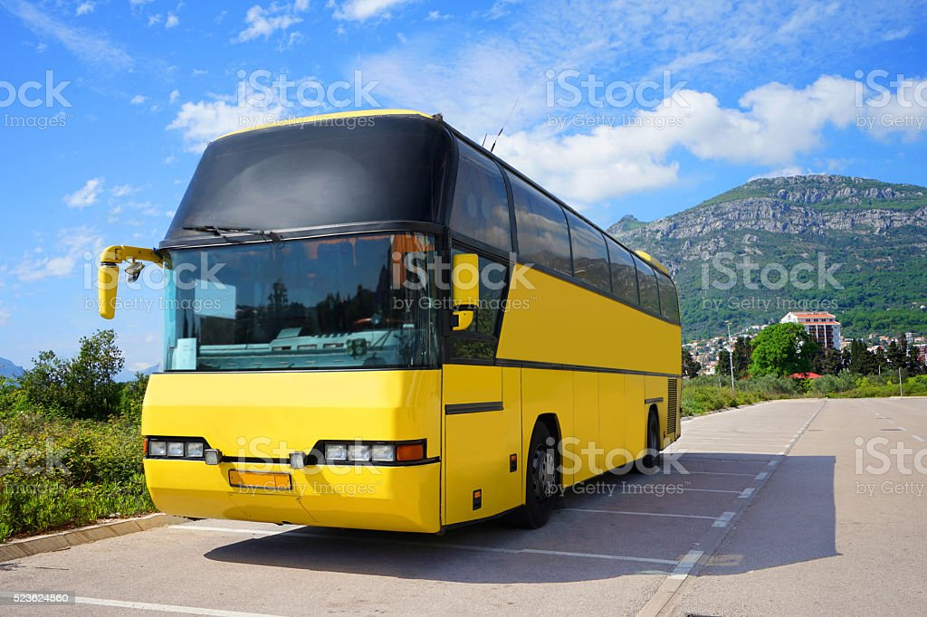 Touristic bus is standing on the parking stock photo