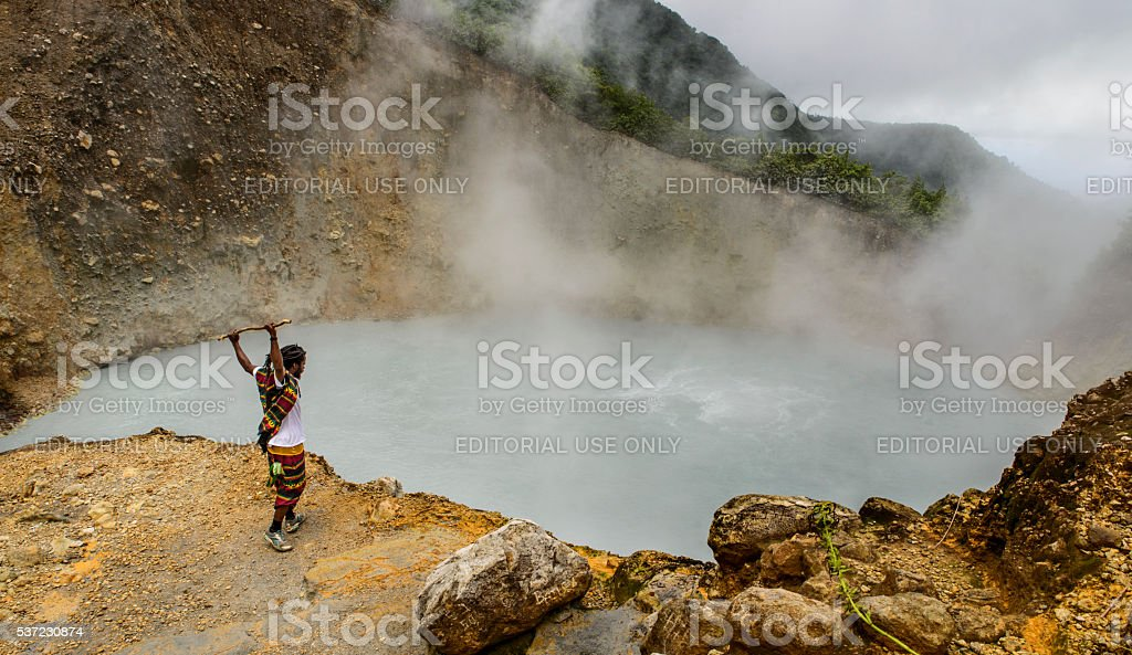 Touristic guide at the Boiling Lake stock photo
