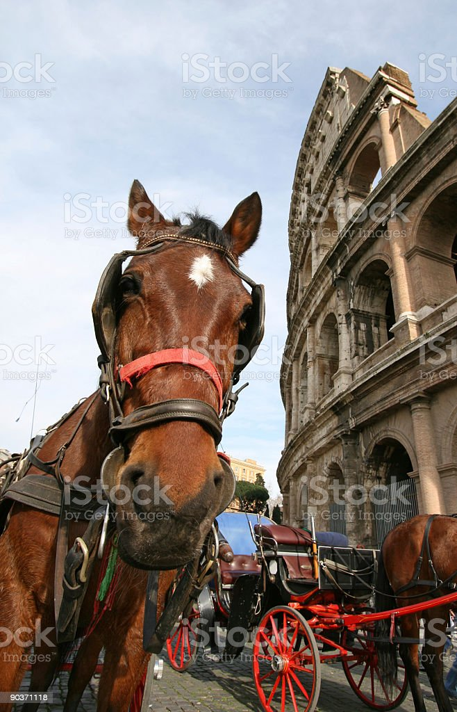 Touristic horse carriage outside Colosseum, Rome Italy royalty-free stock photo