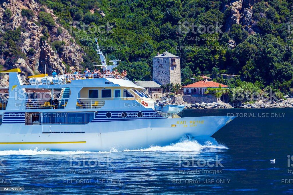 OURANOPOLIS, GREECE - JUNE 05, 2009: Touristic ship near Port Dafna stock photo