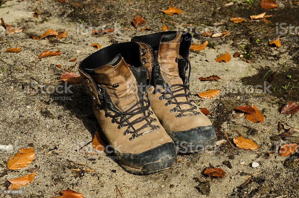 Touristic shoes on a ground stock photo