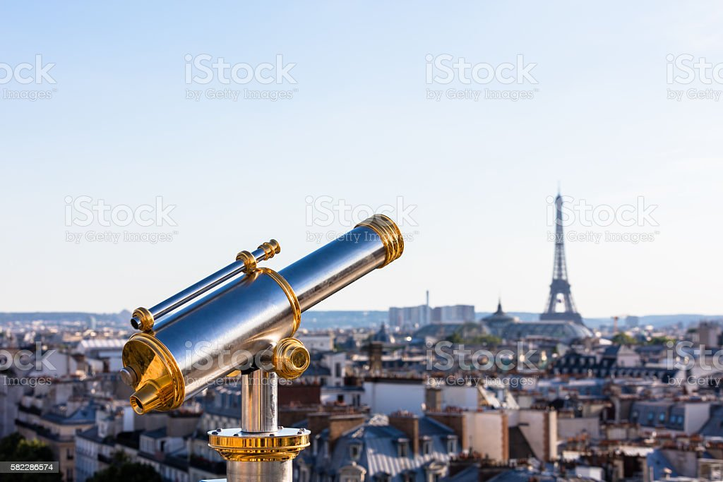 Touristic telescope overlooking Eiffel Tower from roof of Printemps Store royalty-free stock photo