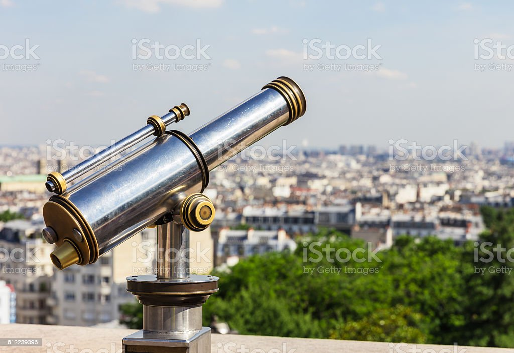 Touristic telescope overlooking Paris from Montmartre hill. Paris, France royalty-free stock photo