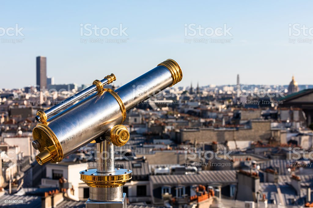 Touristic telescope overlooking Paris from the roof of department store royalty-free stock photo