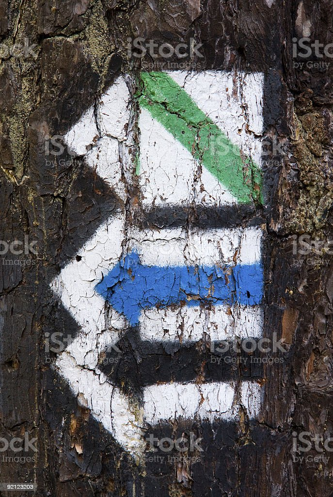 Touristic trail signs on tree bark stock photo