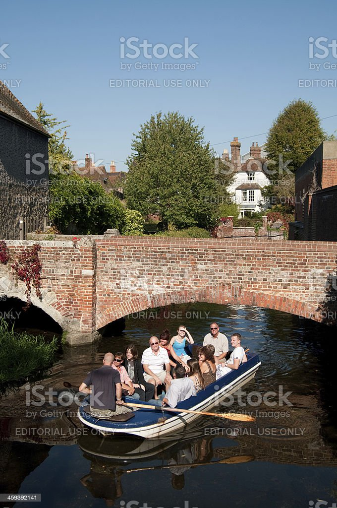 Tourists aboard boat on River Stour in Canterbury England stock photo