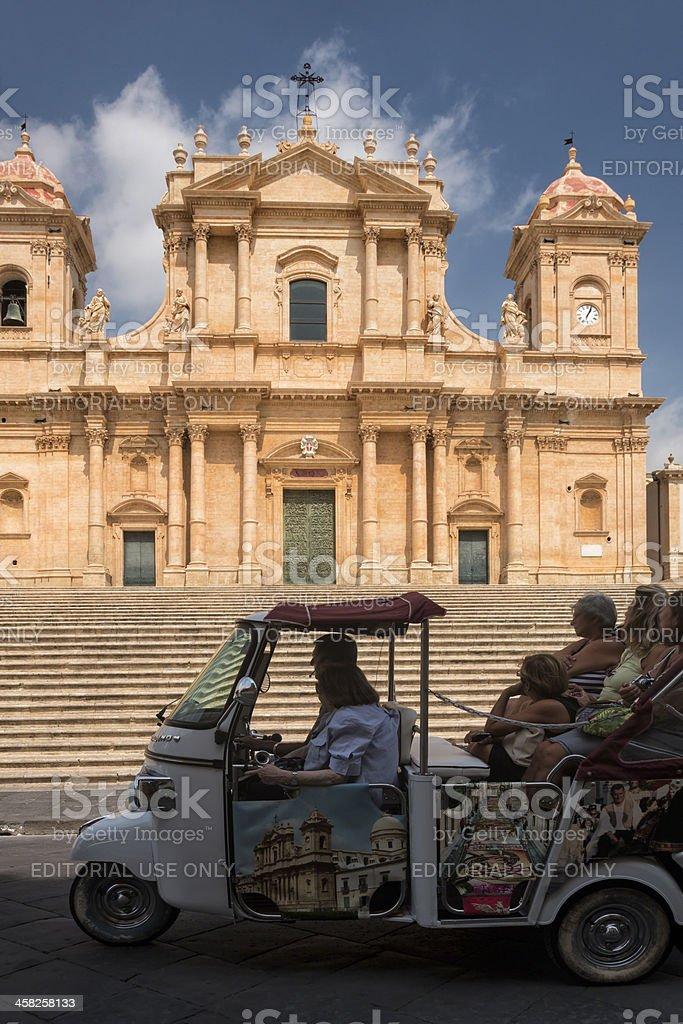 Tourists admire San Nicolo Catedrale, Noto, Sicily, Italy stock photo