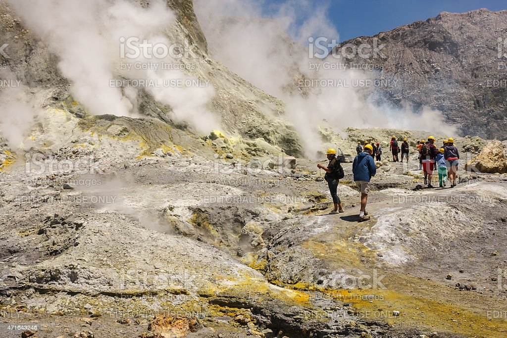 tourists admiring steaming vents on White Island stock photo