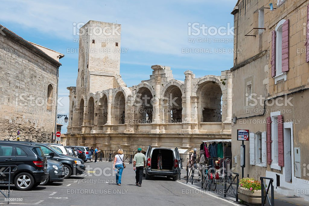Tourists and Arles Ampitheatre in Arles, France stock photo