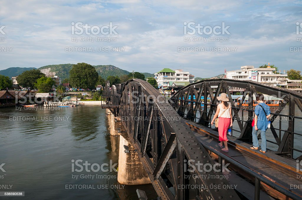 Tourists and Bridge on the River Kwai in Thailand stock photo