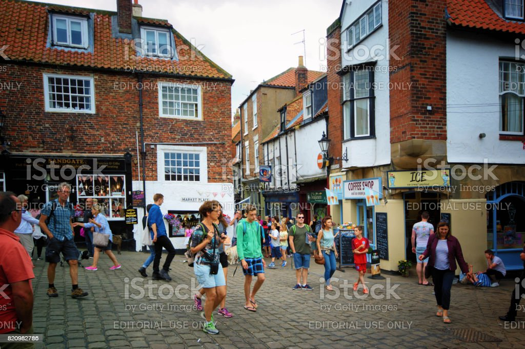 Tourists and dog walkers in Whitby stock photo