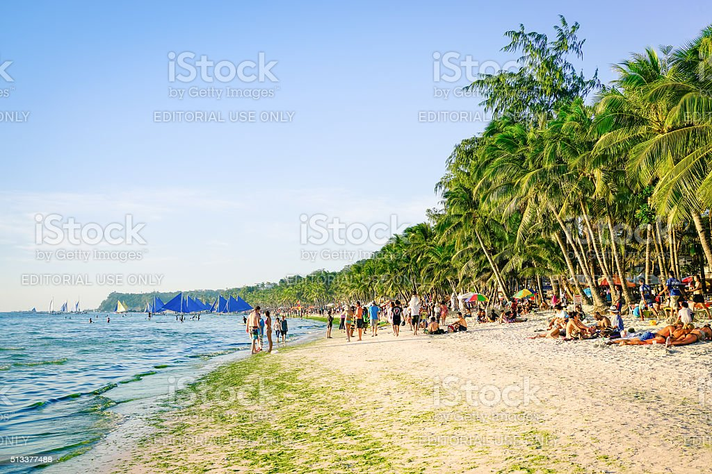 Tourists and everyday life at Boracay beach in Philippines stock photo