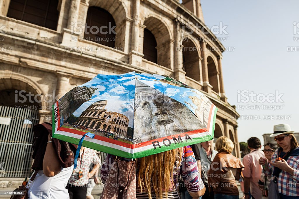 Tourists and guide by the Coliseum royalty-free stock photo