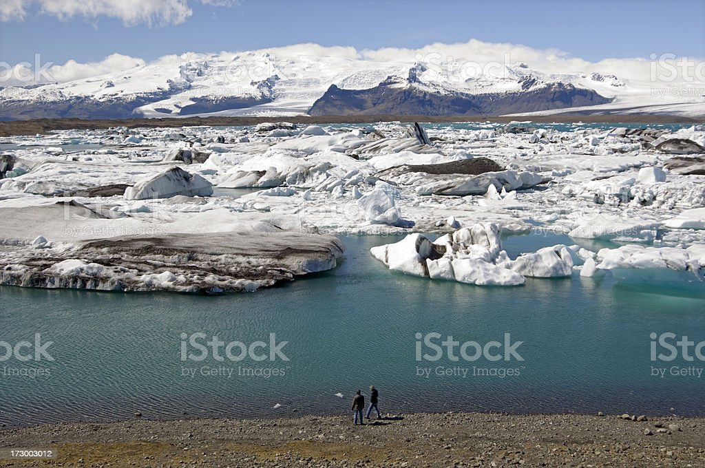 Tourists and icebergs in Iceland stock photo
