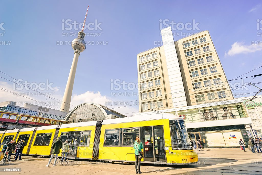 Tourists and local people near tram at Alexanderplatz in Berlin stock photo