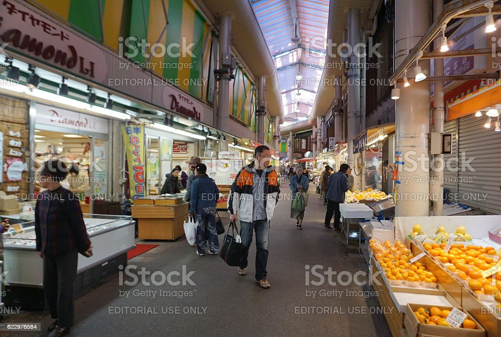 Tourists and local people walking at Ohmi-cho market in Kanazawa stock photo