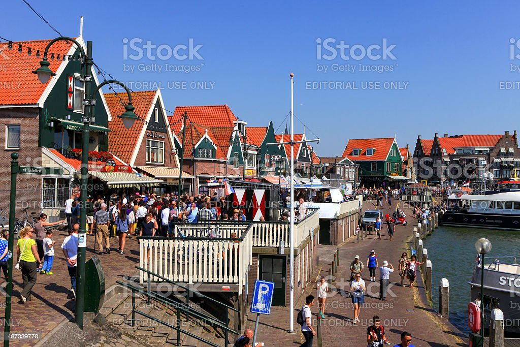Tourists and locals at Volendam's boardwalk. stock photo