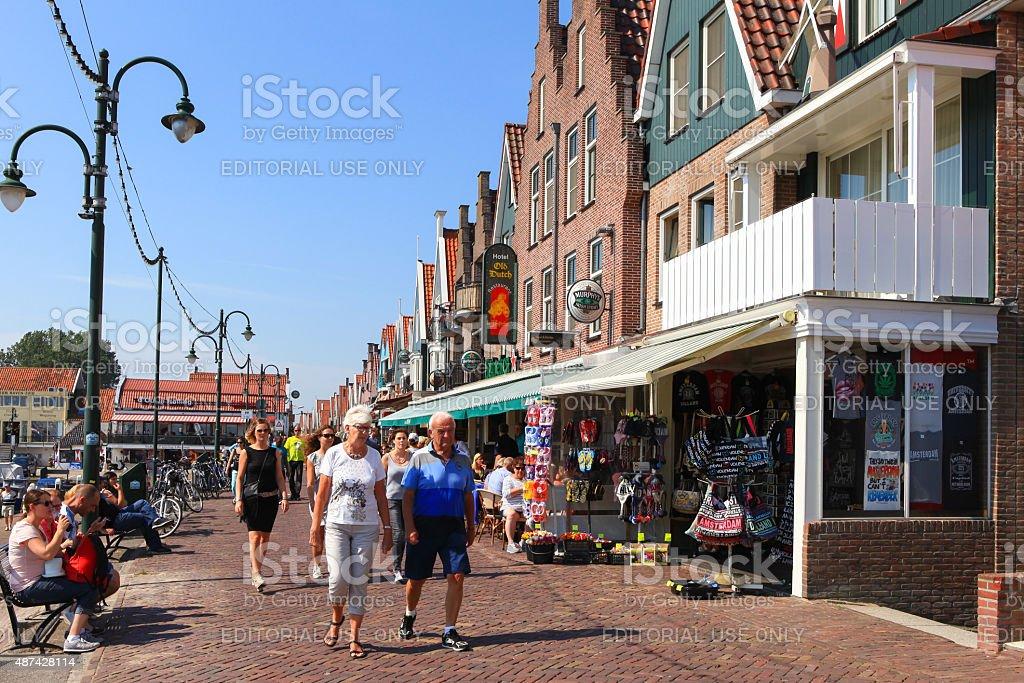 Tourists and locals at Volendam's boardwalk stock photo