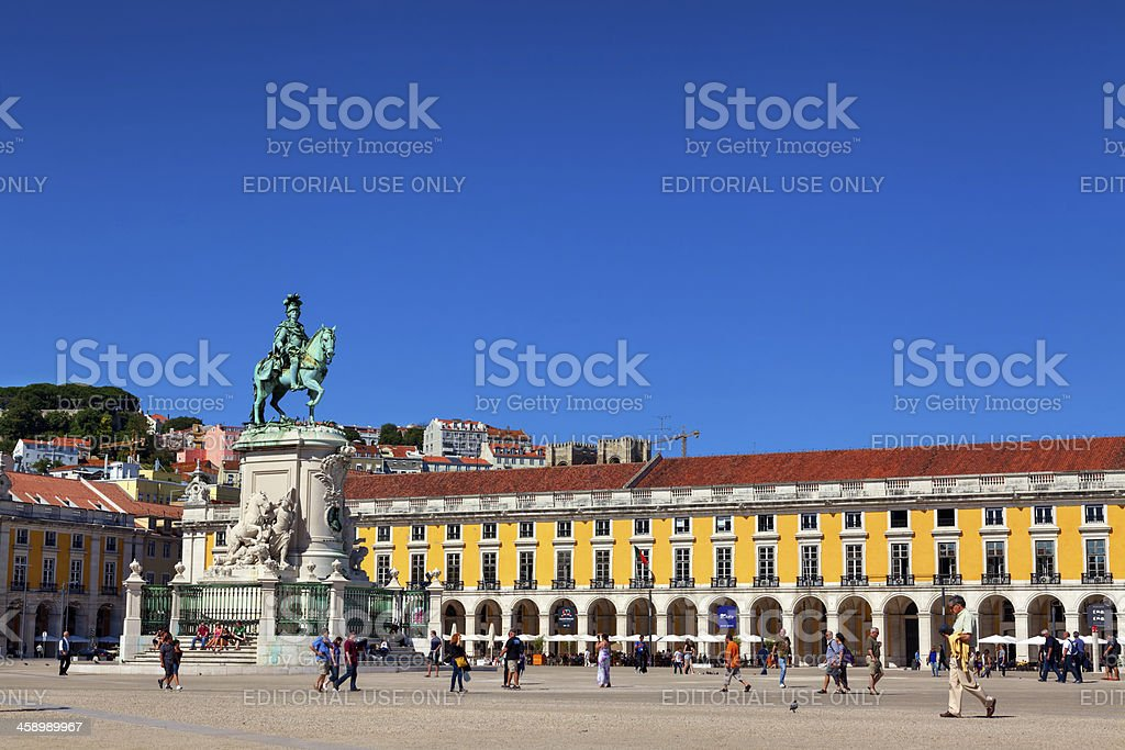 Tourists and locals wandering around the Commerce Square in Lisbon stock photo