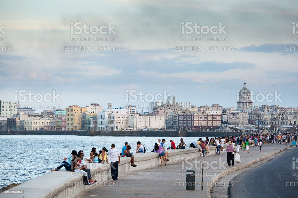 Tourists and Residents Enjoying the Malecón of Havana Cuba stock photo