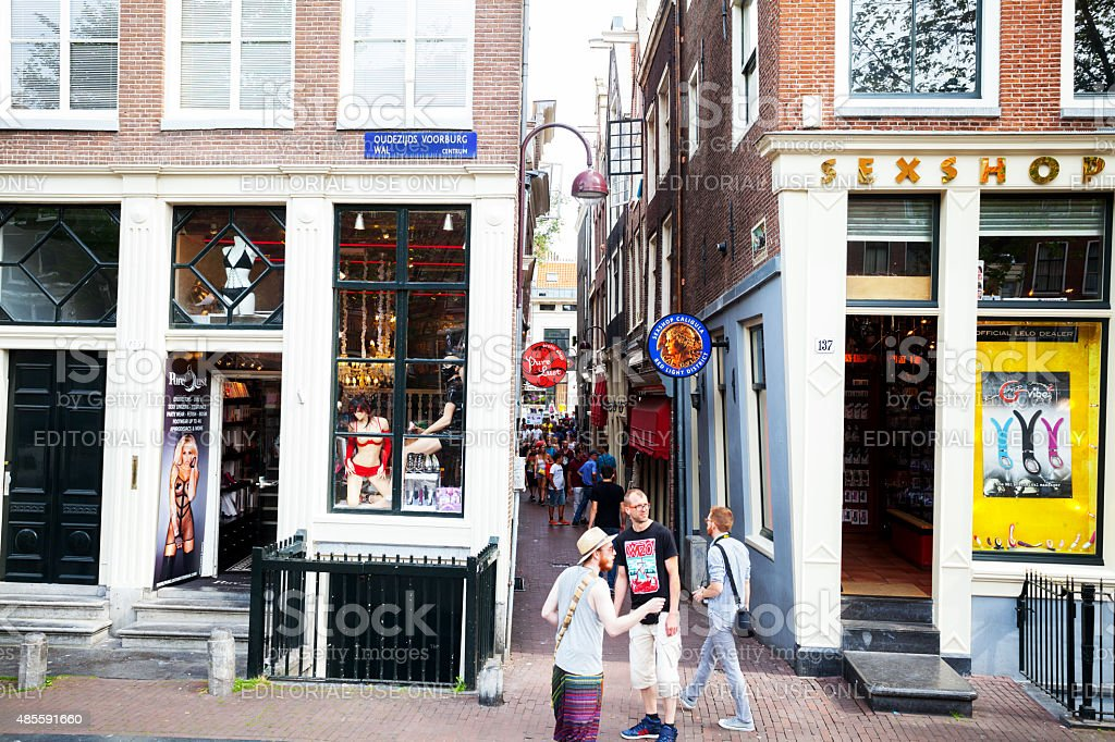 Tourists and sex shops in Wallen of Amsterdam stock photo