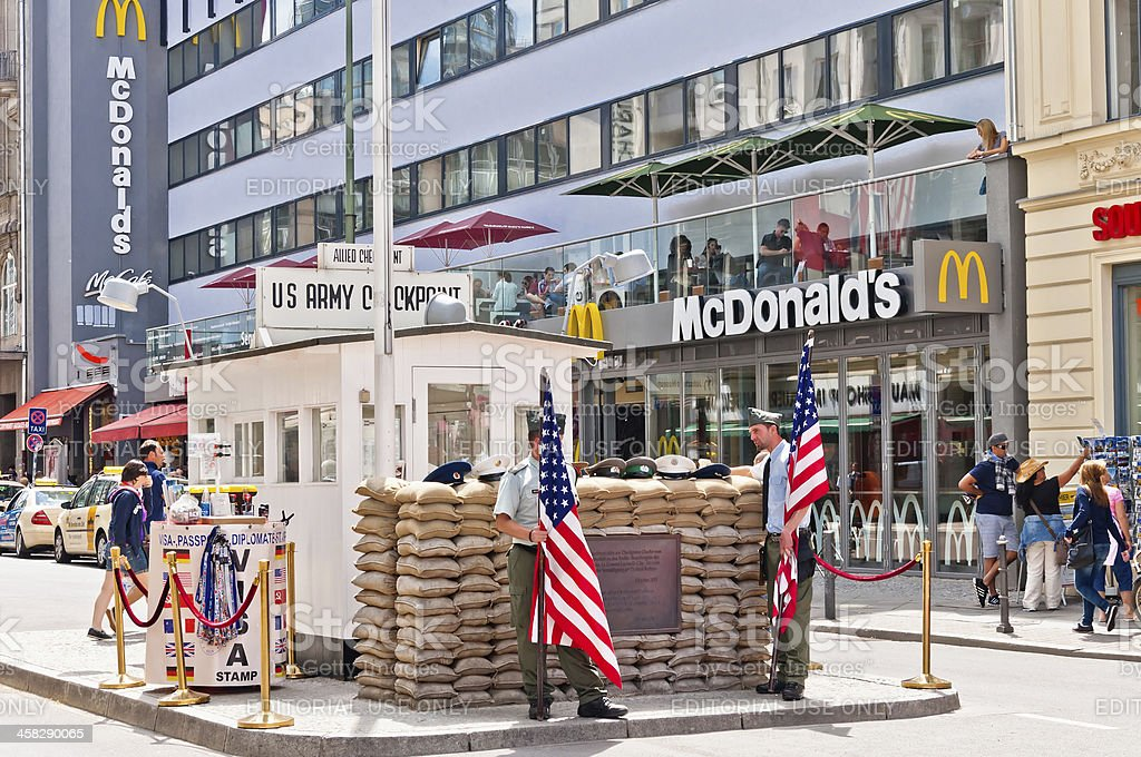 tourists and soldiers at checkpoint Charlie in Berlin stock photo