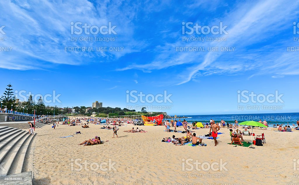 Tourists and swimmers in summer at Coogee Beach stock photo