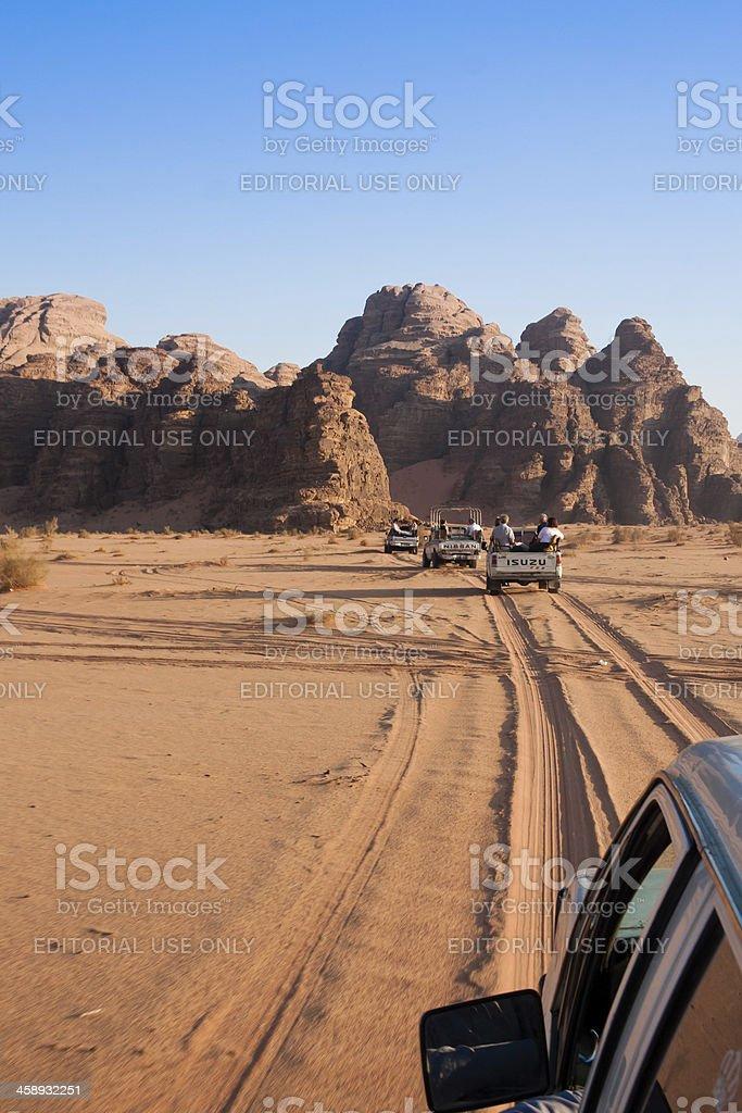Tourists and the Wadi Rum desert in Jordan royalty-free stock photo