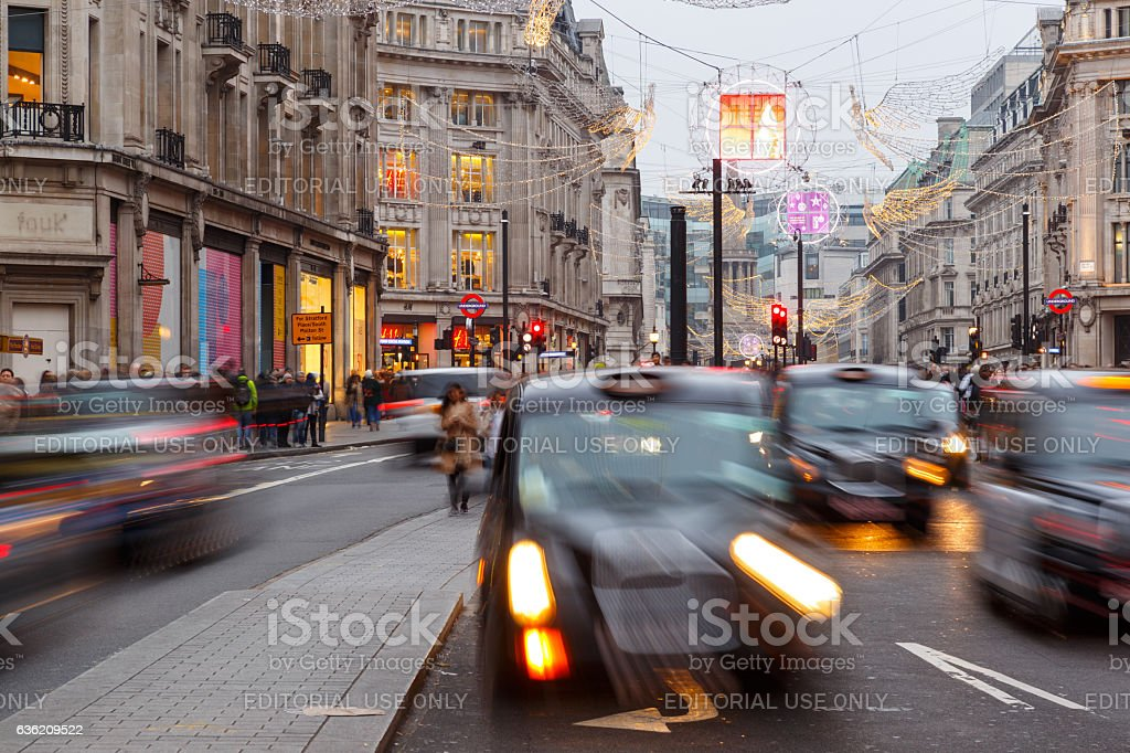 Tourists and traffic on Regent Street at Christmas, London stock photo