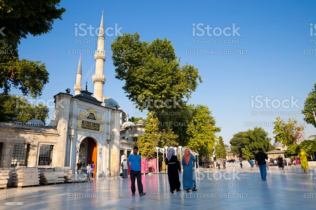 Tourists and Turkish people walking near The Eyup Sultan Mosque stock photo