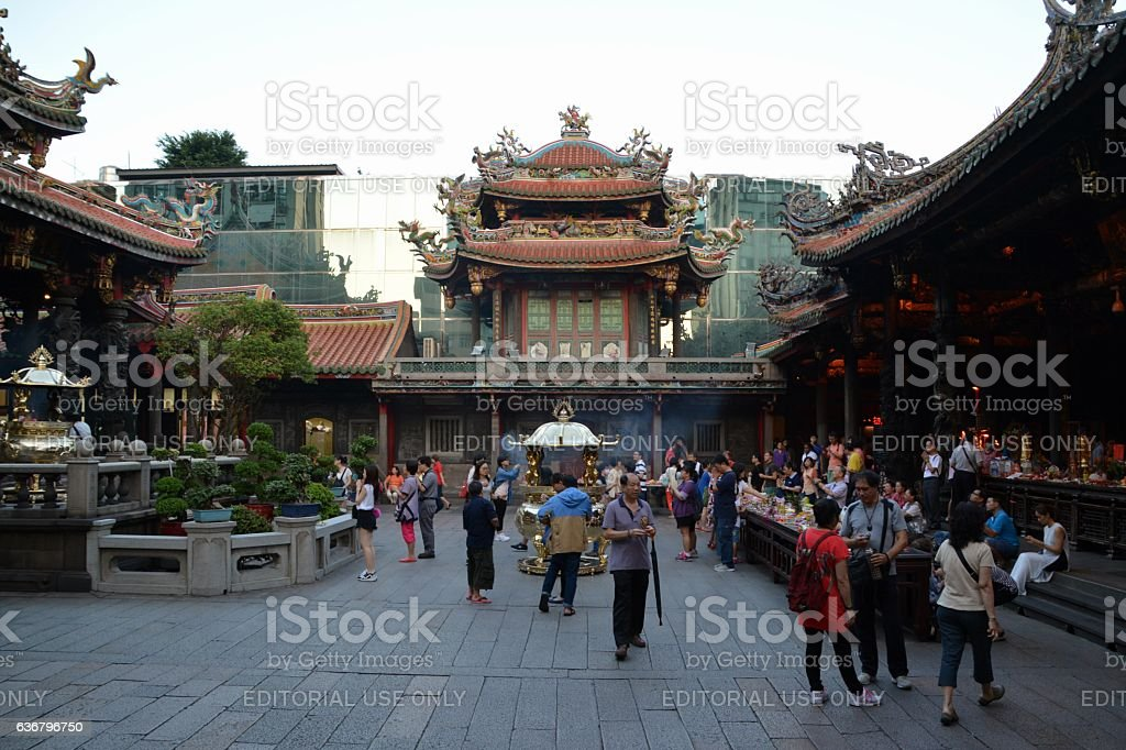 Tourists and worshippers at Longshan Temple, Taipei, Taiwan stock photo