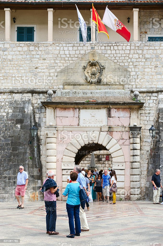 Tourists are at Sea (Western) gate, Kotor, Montenegro stock photo