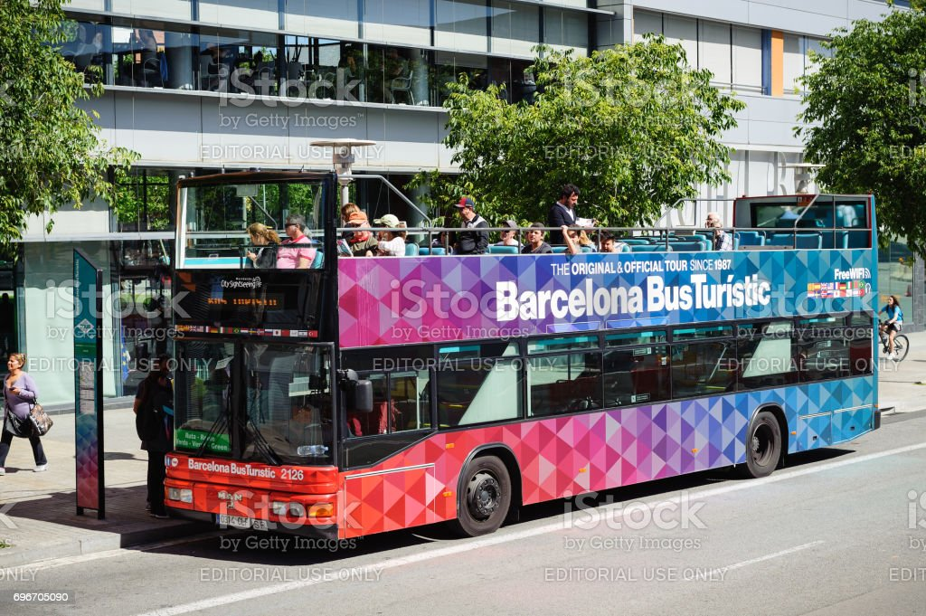 Tourists are driving on City tour excursion bus in Barcelona town, Spain stock photo