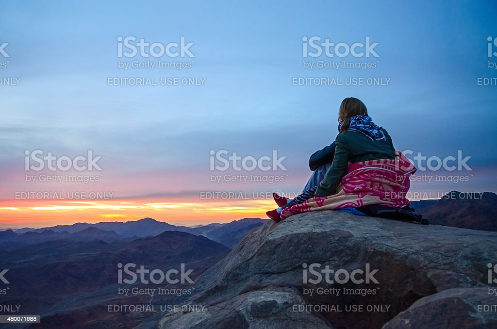 Tourists are greeted sunrise on Mount Moses, Egypt stock photo