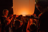 Tourists are launching sky lantern at Thailand
