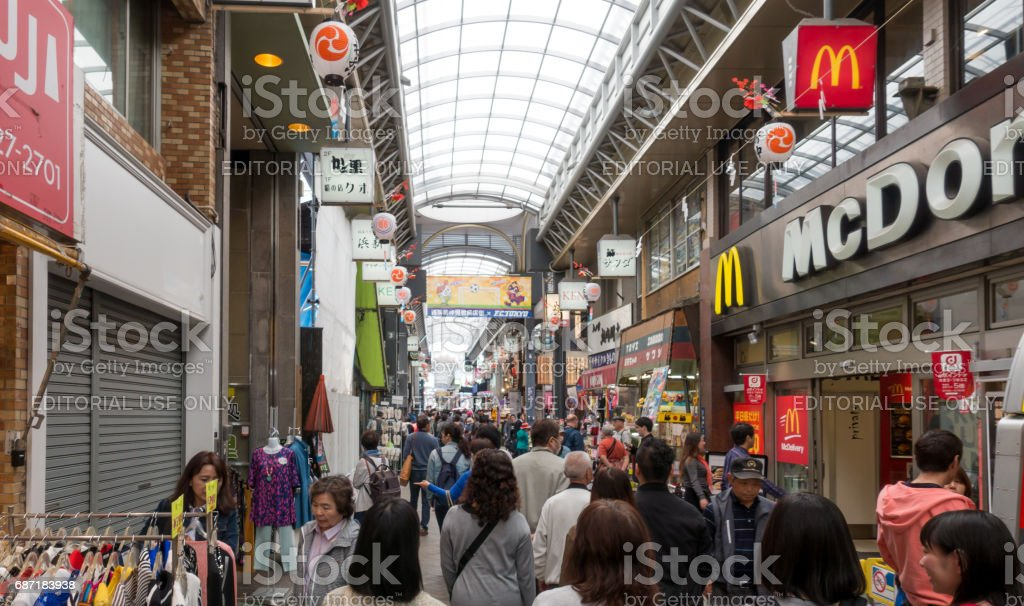 Tourists are shopping in Indoor Shopping Street in Sensoji shrine area. stock photo